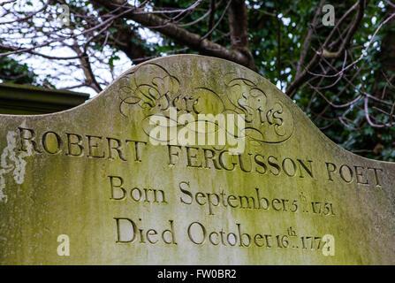 EDINBURGH, SCOTLAND - MARCH 12TH 2016: The grave of famous Scottish poet Robert Fergusson in Canongate Kirkyard - Stock Photo