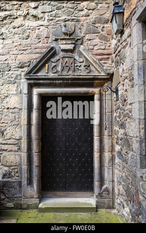 An entrance to Acheson House in the historic city of Edinburgh, Scotland.  The house was built in 1633 (as the marking - Stock Photo