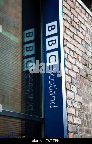 EDINBURGH, SCOTLAND - MARCH 8TH 2016: The BBC Scotland symbol at one of their headquarters on Holyrood Road in Edinburgh, - Stock Photo