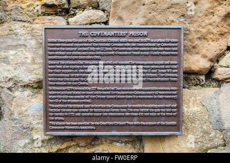 A plaque detailing the location of the Covenanters Prison in Greyfriars Churchyard in Edinburgh. - Stock Photo