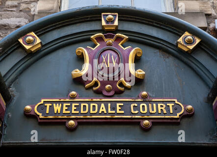 The sign above the entrance to Tweeddale Court along the Royal Mile in Edinburgh, Scotland. - Stock Photo