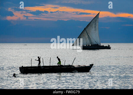 Local dhow boat in front ot the Stone Town beach, Zanzibar, Tanzania - Stock Photo
