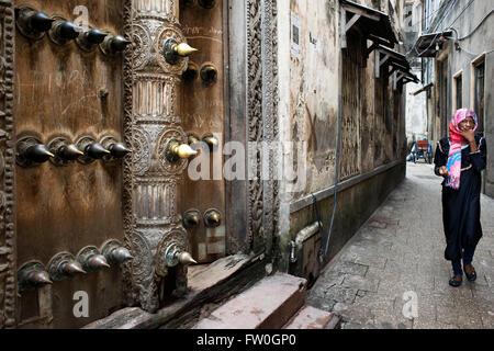 The massive teak doors of one house in Stone Town s maze of narrow streets, Zanzibar, Tanzania. - Stock Photo