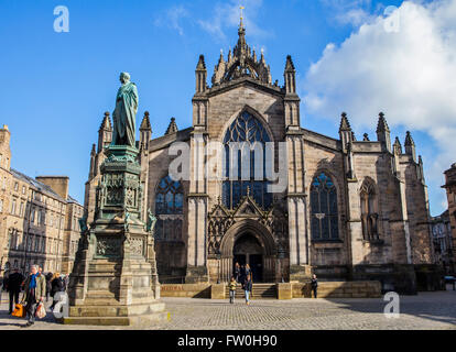 EDINBURGH, SCOTLAND - MARCH 10TH 2016: A view of St. Giles Cathedral and a statue of Walter Scott in Edinburgh, - Stock Photo