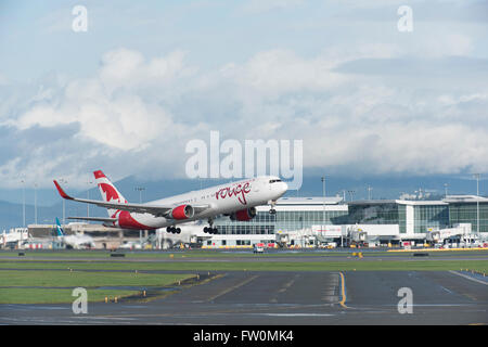 Air Canada Rouge Boeing 767-300 in air after take off from YVR Vancouver  International Airport - Stock Photo