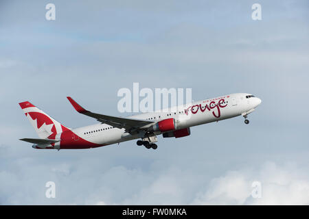 Air Canada Rouge Boeing 767-300 in air after take off from Vancouver International Airport - Stock Photo