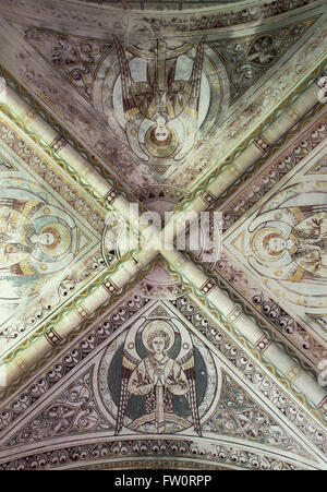 Victorian vaulted ceiling and stenciling in the sanctuary at St Georges Church, Hampnett, Cotswolds, Gloucestershire, - Stock Photo