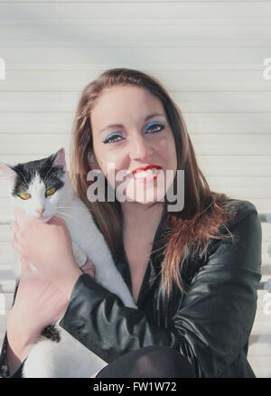 Woman smiling and little cat - Stock Photo