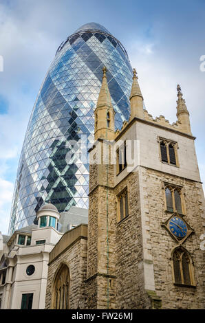 St Andrew Undershaft 15th-century church & 30 St Mary Axe (The Gherkin), London, UK - Stock Photo