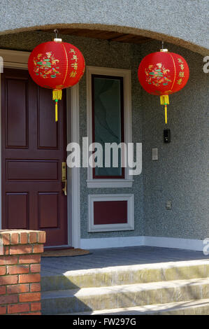 Chinese lunar new year red paper lanterns hanging outside a house in Vancouver, BC, Canada - Stock Photo