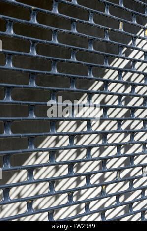 Close Up Of A Metal Link Lattice Rollup Garage Door Stock Photo