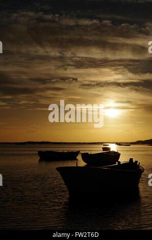Fishing boats in Cacela Velha during sunset. Algarve, Portugal - Stock Photo
