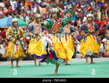 Dancers at the Tashichho Dzong monastery festival, Thimphu, Bhutan - Stock Photo