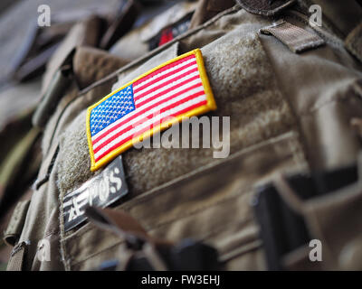 Plate Carrier with USA flag patch shallow depth of field - Stock Photo