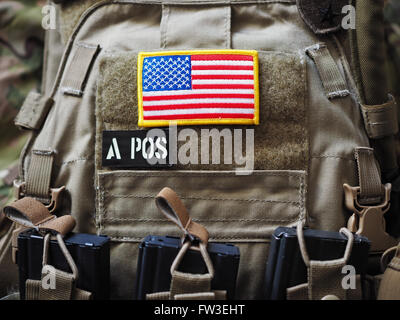 Plate Carrier with USA flag and blood type patches - Stock Photo