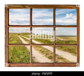 prairie road as seen  through vintage, grunge, sash window with dirty glass - Stock Photo