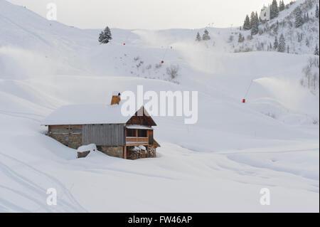 Traditional alpine farm house next to the skiing slopes, Chinaillon, Le Grand Bornand, Lake Annecy Ski Resorts, - Stock Photo