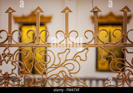 Image of ornate painted iron fencing. - Stock Photo