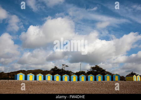 Beach Huts under a dramatic sky at Littlehampton West Sussex - Stock Photo