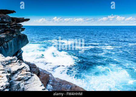 Rock formations eroded by wind and water along the Bondi to Coogee coastal cliff top walk in Sydney's Eastern suburbs - Stock Photo
