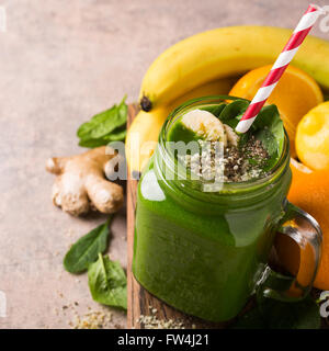Healthy green smoothie with spinach in glass jar - Stock Photo