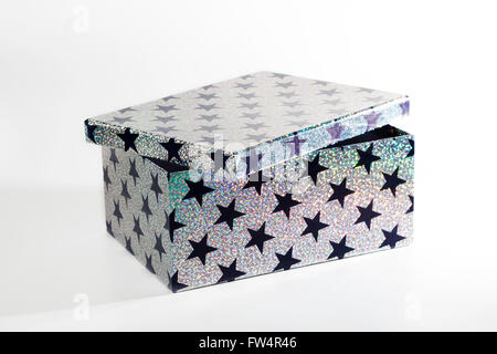 Giftbox with glitters and stars, isolated on white background - Stock Photo