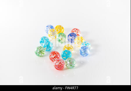 colored marbles on white studio background - Stock Photo