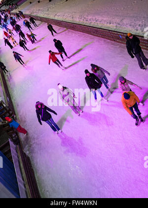 VDNH Expo Center, Moscow, Russia - February 06, 2016: Young people skating on the public ice rink - Stock Photo