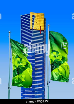 Through vibrant green flags of Federation Square, offer stunning views of Melbourne's highest skyscraper, 297.3m - Stock Photo
