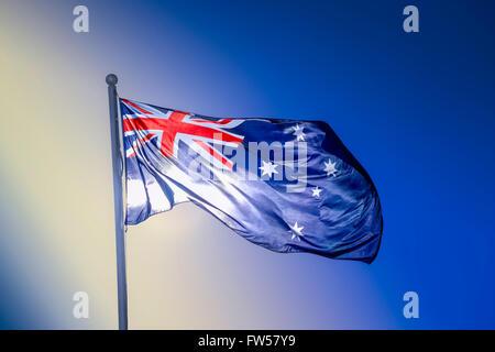 Australian national flag waving in the wind, Melbourne Australia - Stock Photo