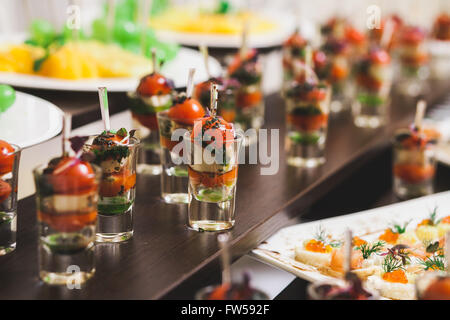 Catering for party. Close up of sandwiches, appetizers and fruit - Stock Photo
