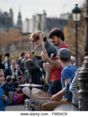 Musicicans on Pont Saint Louis, Paris - Stock Photo