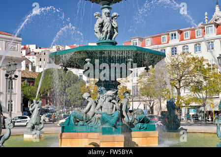 Portugal, Lisbon: Water fountain at square Dom Pedro IV ( Rossio ) - Stock Photo