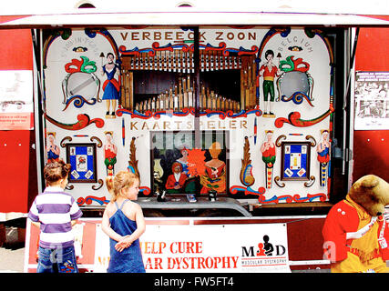 Street organ in Holland - with children watching - by Verbeek, Holland, c.1991. Painted figures in traditional costume. - Stock Photo