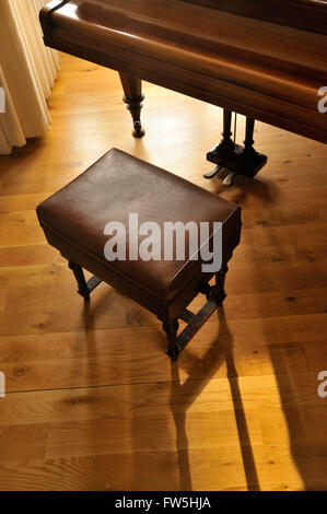Bechstein Model A grand piano - pedals and lyre, pre 1900, with wooden concert piano stool, padded leather, adjustable - Stock Photo