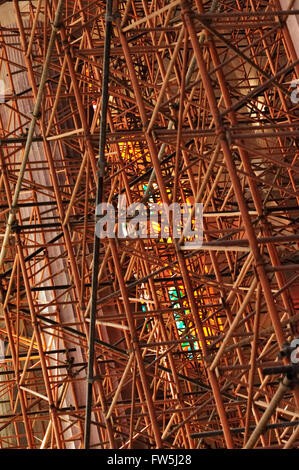 scaffolding inside Barcelona Cathedral of Sagrada Familia, designed by Catalan Spanish modernist architect Antoni - Stock Photo