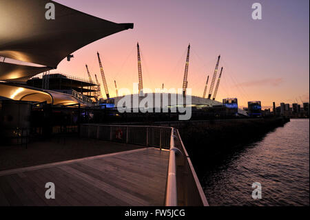 sunset view from the River Thames high-speed ferry landing stage, of the O2 Arena, Millennium Dome (Millenium), - Stock Photo