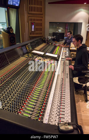 Sound mixing desk, Abbey Road Studios, London NW8, Studio 1. With sound engineer at controls. Studio One is the - Stock Photo