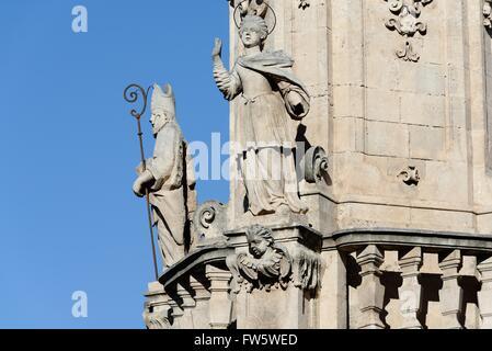 Statues on baroque obelisk to Saint Oronzo in Ostuni - Stock Photo
