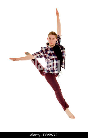 Skilled Male Lyrical or Contemporary Dancer Leaps in a Jete with a bit of attitude - Stock Photo