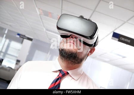 virtual reality headset worn by mature man - Stock Photo