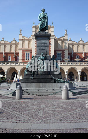Poland, Krakow, Old Town, Adam Mickiewicz Monument - Polish Romantic poet and Cloth Hall - Sukiennice - Stock Photo