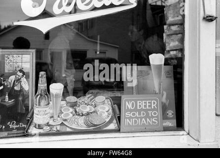 Racial Discrimination. 'No Beer Sold to Indians' sign in the window of a bar in Sisseton, South Dakota, USA. Photo - Stock Photo
