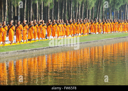 Monks next to pine forest, reflection, Thudong or Dhutanga, Wat Phra Dhammakaya, Khlong Luang District, Pathum Thani, - Stock Photo