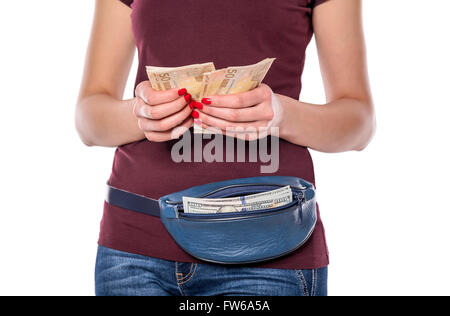 Female hands counts the money. Silhouette of a woman with a purse on a white background. - Stock Photo