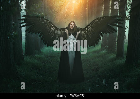 Fallen angel with sad expression and eyes to the sky - Stock Photo