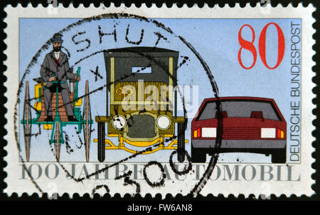 GERMANY - CIRCA 1986: A stamp printed in Germany dedicated to the 100th anniversary of the car, shows Benz Tricycle, - Stock Photo