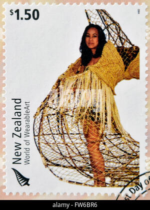 NEW ZEALAND - CIRCA 2004: Stamps printed in New Zealand dedicated to World of WearableArt shows Taunga Ika by Louise - Stock Photo