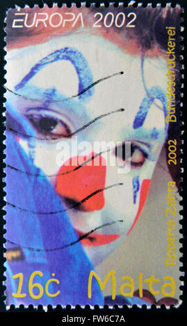 MALTA - CIRCA 2002: A stamp printed in Malta shows image of a clown, circa 2002 - Stock Photo