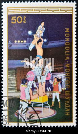 MONGOLIA - CIRCA 1986: A stamp printed in Mongolia shows Acrobats, circa 1986 - Stock Photo